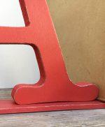 Fermalibro in legno colorato con lettera
