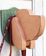 Testa di cane in legno per appendere il guinzaglio