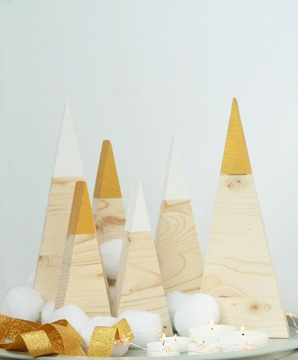 Abeti natalizi con punta bianco e oro in stile nordico