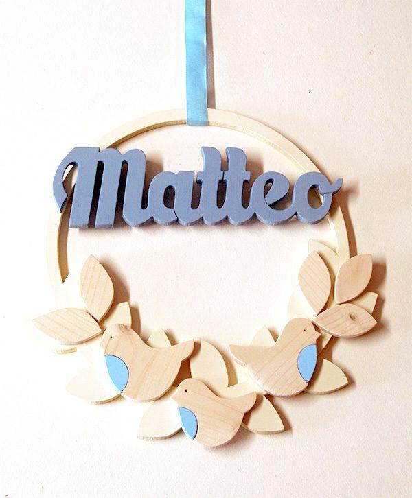 Ghirlanda in legno con nome bambina e decorazioni
