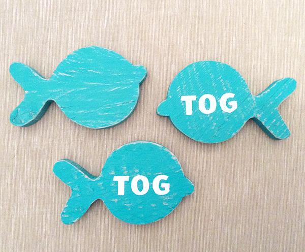 Produzione pesci in legno con logo per evento aziendale
